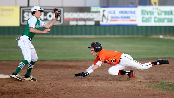 Iowa Park's Braxton Briones makes the tag on Burkburnett's Kody Bigford Tuesday night in 6-4A action. The Hawks won, 9-0.