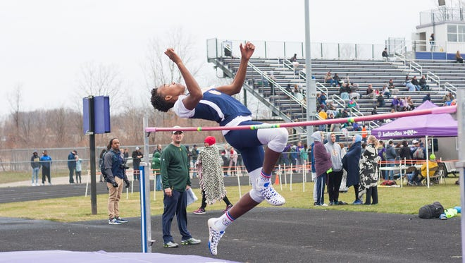 Theo Shepard of Battle Creek Central in the high jump in action earlier this season.