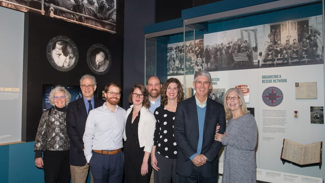 Ron Doeppner and his family pose for a photo after viewing the new Americans and the Holocaust Exhibition at the United States Holocaust Memorial Museum on April 19, 2018.  Some artifacts from the Doeppner family are included in the exhibition.
