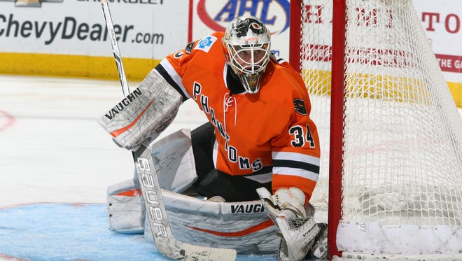 Alex Lyon made 23 saves on 26 shots before he was ejected in the third period.