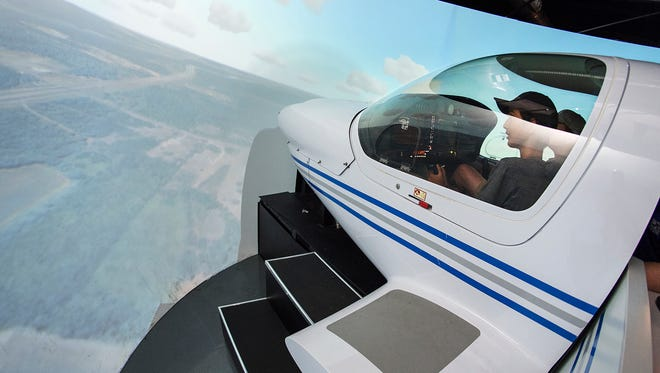 Thomas Kelly, 12, left, and Graham Jones, 15, fly one of the flight simulators Thursday, June 14, at the Murfreesboro Airport during the 2018 Introduction to Aviation and Professional Pilot Advanced Camp.
