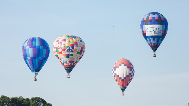 Balloons pop up from flying low so they can visually find the first target at Dexter Lake Church Friday morning