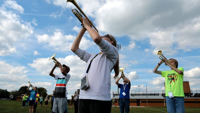 Samantha Mercer plays with other trumpeters during River View's marching band practice earlier this year.