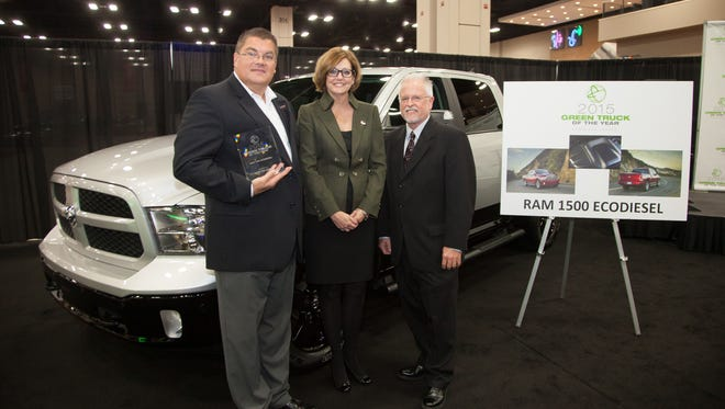 Bob Hegbloom, CEO of Chrysler Group's Ram truck brand, left, and Pam Crail, president of the San Antonio Auto Dealers Association, after Ram was given the Green Truck of the Year Award by Green Car Journal publisher Ron Cogan, right.