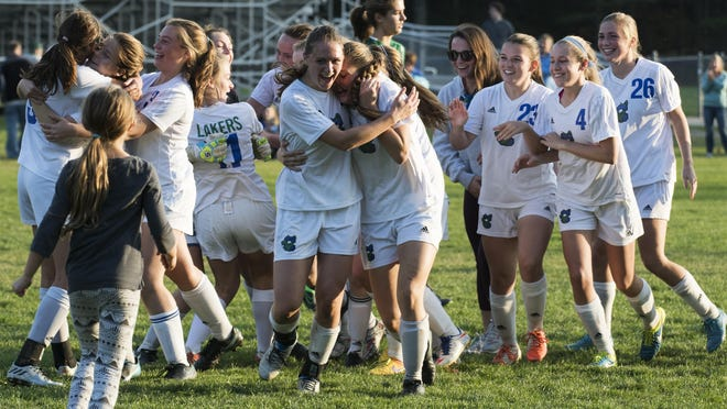 Colchester celebrates at the conclusion of the girls soccer semi final game between the St. Johnsbury Hilltoppers and the Colchester Lakers at Colchester High School on Wednesday afternoon November 2, 2016 in Colchester.