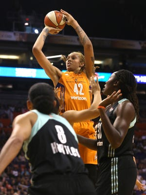 Mercury's Brittney Griner (42) shoots over Liberty's Kiah Stokes (41) in the first half at Talking Stick Resort Arena in Phoenix, Ariz. on July 9, 2017.