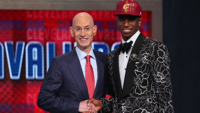 Andrew Wiggins from Kansas shakes hands with NBA commissioner Adam Silver after being selected as the No. 1 overall pick to the Cleveland Cavaliers in the 2014 NBA Draft at the Barclays Center Thursday night.