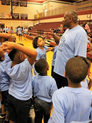 Jackson City Councilman Johnny Dodd encourages a group of young participants during the Aug. 19 Bounce Back Youth Basketball Camp at Liberty Technology Magnet High School.