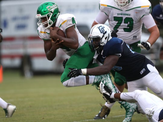 Gadsden County's Marquise Sailor tries to drag down