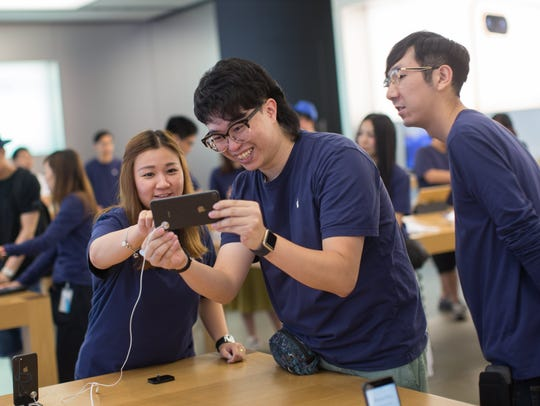 Apple Store staff use the company's new iPhone 8 at