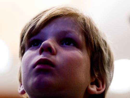 Henry Jay watches the leaderboard during the GOP watch