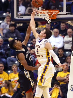 Guerin Catholic's Matt Holba defends the basket against Griffith's Tremell Murphy during the Golden Eagles' 62-56 win over the Panthers in the state finals to win the IHSAA Class 3A Boys State Basketball Championship at Bankers Life Fieldhouse in Indianapolis on Saturday, March 28, 2015.