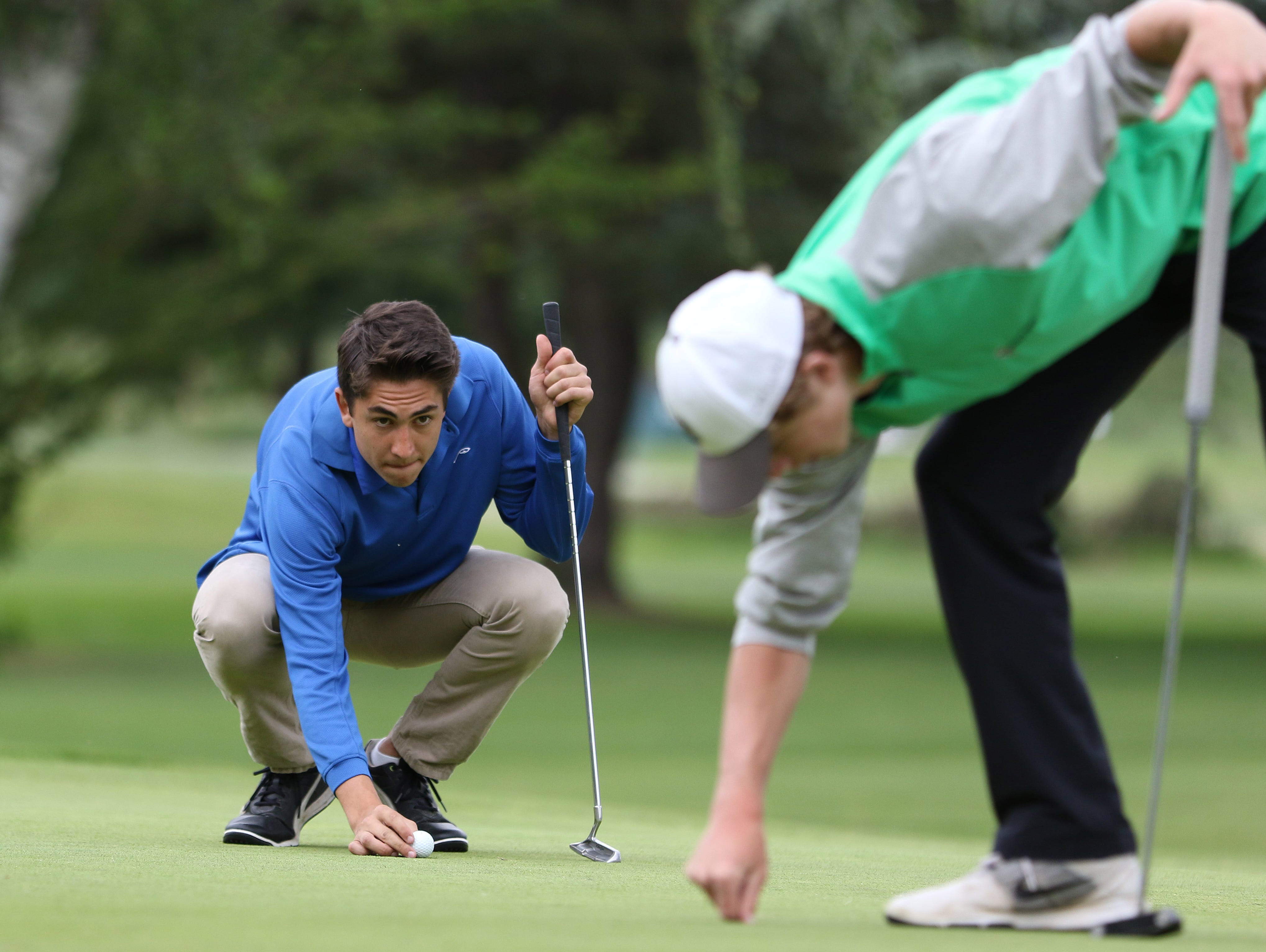 Blanchet's Nick Conway lines up a putt during the first day of the OSAA 3A/2A/1A State Golf Tournament on Monday, May 16, 2016, at Emerald Valley Golf Club in Creswell.