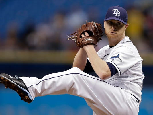 FILE - In this June 20, 2017, file photo, Tampa Bay Rays starting pitcher Alex Cobb high-kicks as he delivers to the Cincinnati Reds during the first inning of a baseball game in St. Petersburg, Fla. The Rays will have their 500th consecutive start by a pitcher under 30, the major leagues' longest current run, when Cobb faces the Baltimore Orioles on Wednesday, July 26. (AP Photo/Chris O'Meara, File)