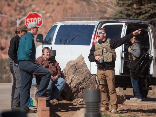 Agents from the FBI and other law enforcement make arrests and collect evidence in Hildale Tuesday, Feb. 23, 2016.