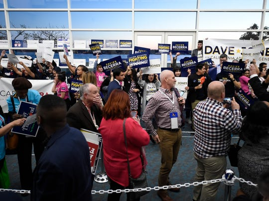 Delegates, foreground, wait in line to vote at the 2018 California Democrats State Convention Saturday, Feb. 24, 2018, in San Diego. (AP Photo/Denis Poroy)