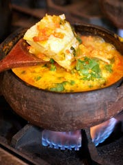 A fish moqueca, or stew, is prepared in a clay pot of the same name. The dish is a specialty at Moqueca Brazilian Cuisine in Oxnard.