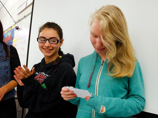 "Jackson Liberty High School student Elizabeth Yeatman, 15, reads an excercise wit Alysia Thomas, 18, applauds during the ""Thursdays with Friends"" session, November 3, 2016.  The weekly class helps build build empathy and fosters social-emotional growth in students there."