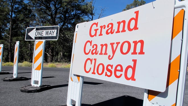 FILE - This Oct. 3, 2013 file photo shows a sign at the south entrance to Grand Canyon National Park, Ariz., indicates the park is closed.