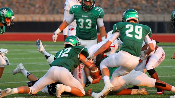 Iowa Park's Reid Lalk (12) forces a fumble against