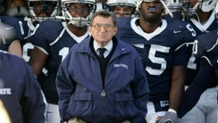 Joe Paterno's victory total stands at 409, putting