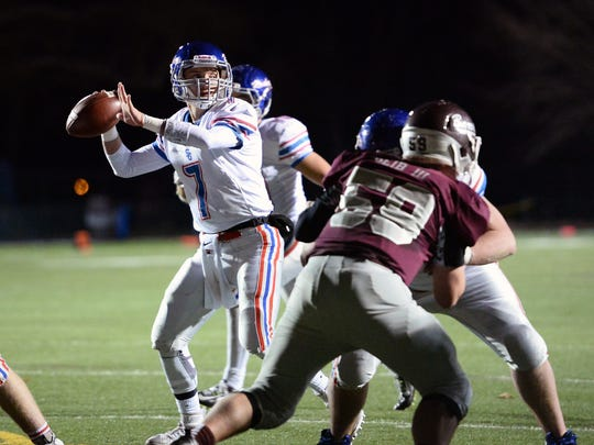 Spring Grove quarterback Jake Messersmith stands in the pocket during Friday's District 3 Class AAA first-round game against Manheim Central.