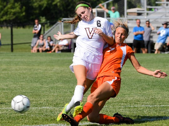 Ames' Kelly Friedrich (7) and Valley's Abbey Vanwyngarden (6) battle for the ball on Saturday, June 10, 2017, during the 3A state soccer Finals at Cownie Soccer Park.