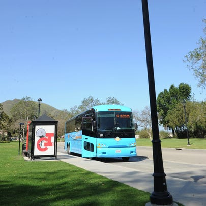 A bus pulls up to a bus stop at CSU Channel Islands.