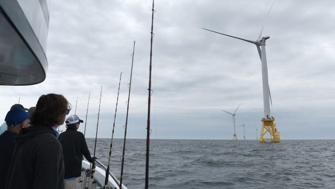 Guests aboard the Seven B's V fishing boat get a look at the Block Island Wind Farm. A new coalition, New England for Offshore Wind, is working to further efforts to bring similar farms and projects to the region.