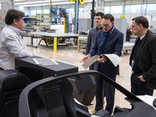 Amko Leenarts Head Designer Of The Ford Gt Supercar Interior Discusses The Interior Of A Styrofoam Model With Ford Design Chief Moray Callum Left