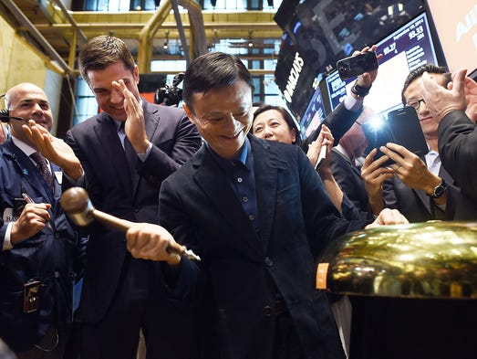 Jack Ma, founder of Chinese online retail giant Alibaba, rings a bell to open trading on the floor at the New York Stock Exchange on Sept. 19 in New York.