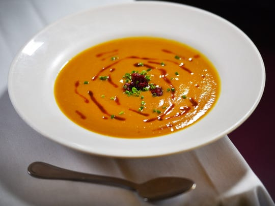 Photo of a bowl of butternut squash bisque prepared