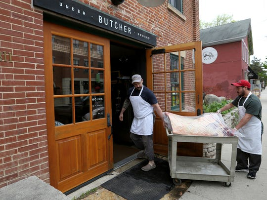 Steve Dawson, butcher, and Wesley Aniel, cart in a