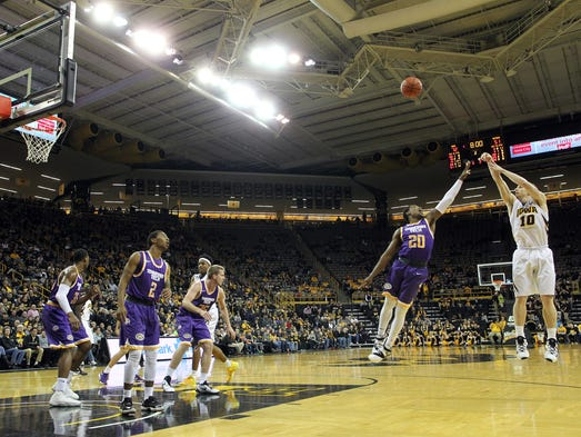 Iowa's Mike Gesell shoots a 3-pointer during the Hawkeyes'