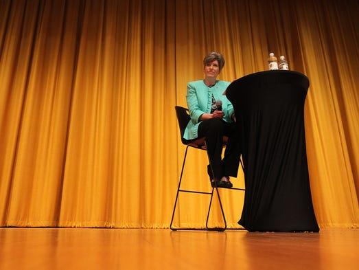 Sen. Joni Ernst (R-Iowa) speaks with Iowans during