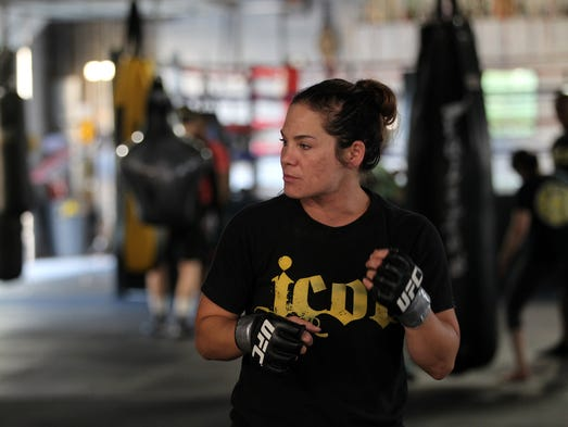 Julie Kedzie works with fighters at her MMA class at
