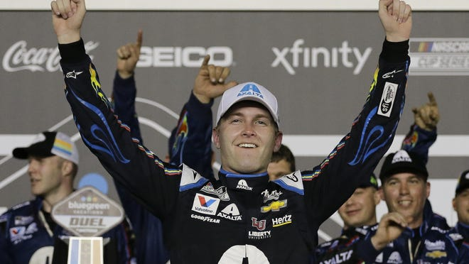 William Byron, seen here celebrating a Daytona 500 qualifying race, won his second consecutive NASCAR virtual race by holding off Timmy Hill, the driver who moved him out of the way to win an earlier iRacing event.
