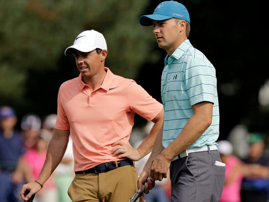 Jordan Spieth, right, talks with Rory McIlroy, from Northern Ireland, on the first hole during the second round of the Bridgestone Invitational golf tournament at Firestone Country Club, Friday, Aug. 4, 2017, in Akron, Ohio. (AP Photo/Tony Dejak)