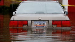 A car is flooded in front of Winyah Apartments in Georgetown,
