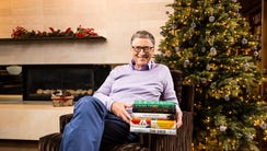 Bill Gates with his favorite books this year.