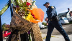 Flowers and notes are left at a makeshift memorial