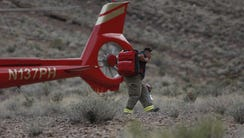 First responders arrive at the scene of a deadly helicopter