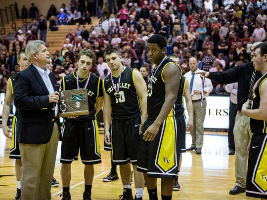 Players from Tri-Valley's boys basketball team accept the Division I district runner-up trophy after a 51-41 loss to Newark in 2015 at Ohio Dominican.