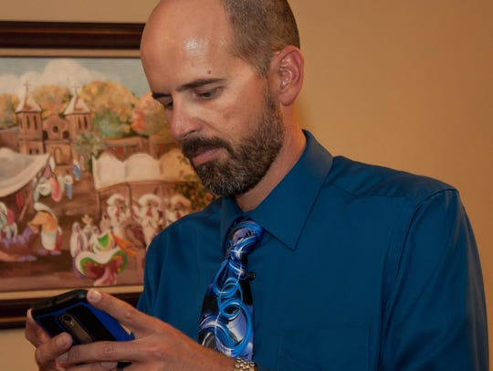 James Dickens turns to his phone after receiving news