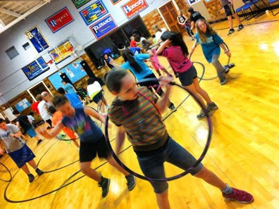 """""""Springfield Hoops for Kids, a volunteer organization, raises funds to provide free hula hoops, along with at-school demonstrations, and instruction at city elementary schools in the city of Springfield, Mo."""""""