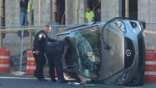 Tallahassee Police are investigating a traffic crash downtown in which a vehicle has flipped on its side.