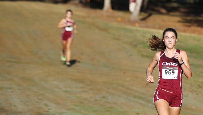 Chiles senior Alexandra Wallace sprints toward the finish ahead of her sister, sophomore Ava Wallace, during a cross country meet Saturday at Apalachee Regional Park.