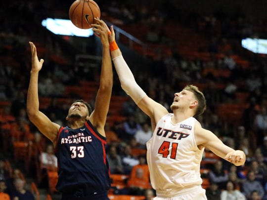 UTEP center Matt Willms, 41, battles for a rebound with Amir Smith, 33, of Florida Atlantic Thursday night.
