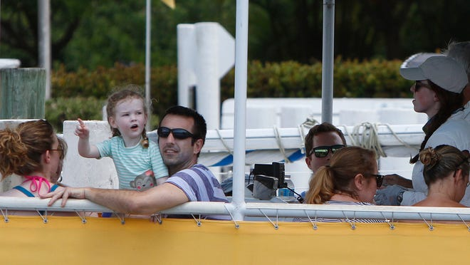 Rebekah, Cora, 3, and Andy Folsom, left, head out on a Sea Life Tour with the Adventures in Paradise cruise Wednesday in Fort Myers.