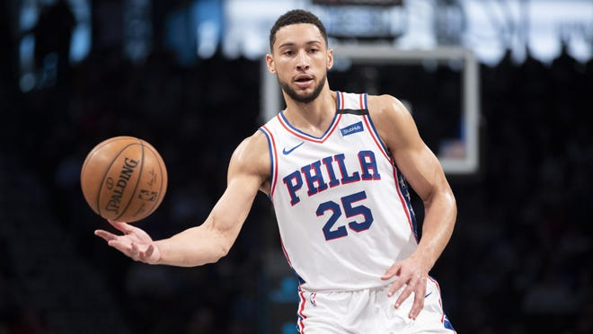 FILE - In this  Monday, Jan. 20, 2020 file photo, Philadelphia 76ers guard Ben Simmons moves the ball during the first half of an NBA basketball game against the Brooklyn Nets in New York. All-Star guard Ben Simmons says he's feeling strong in his recovery from a lower back injury and expects to be at full strength once the NBA season resumes. Simmons, who averaged 16.7 points, 7.8 rebounds and 8.2 assists in 54 games, was hurt in a Feb. 22 game at Milwaukee.